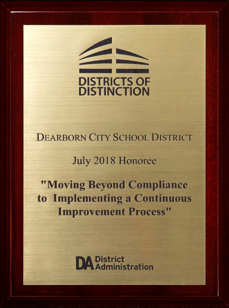 "Districts of Distinction plaque says Dearborn City School District, July 2018 Honoree, ""Moving Beyond Compliance to Implementing Continuous Improvement Process"""