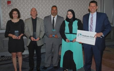 Impact Awards given to four District employees