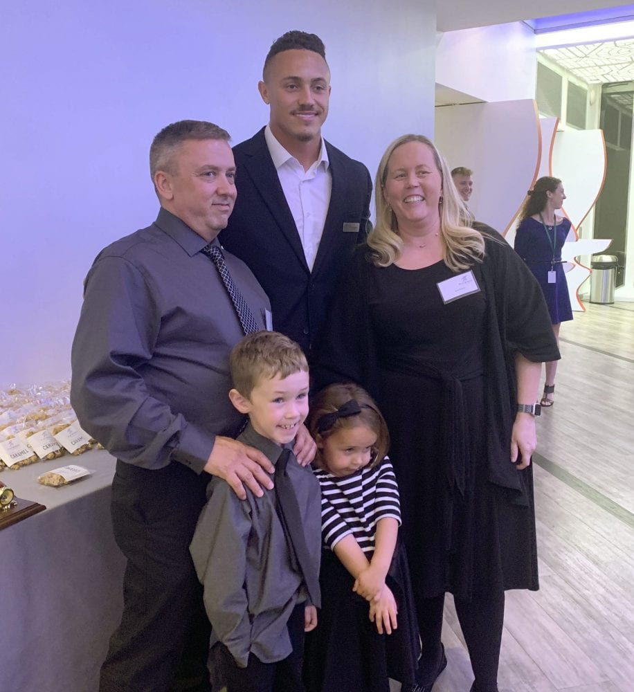 Amy Modica, her husband and two children pose with Detroit Lions linebacker Miles Killebrew during the Playworks Michigan awards event on Oct. 3, 2019.