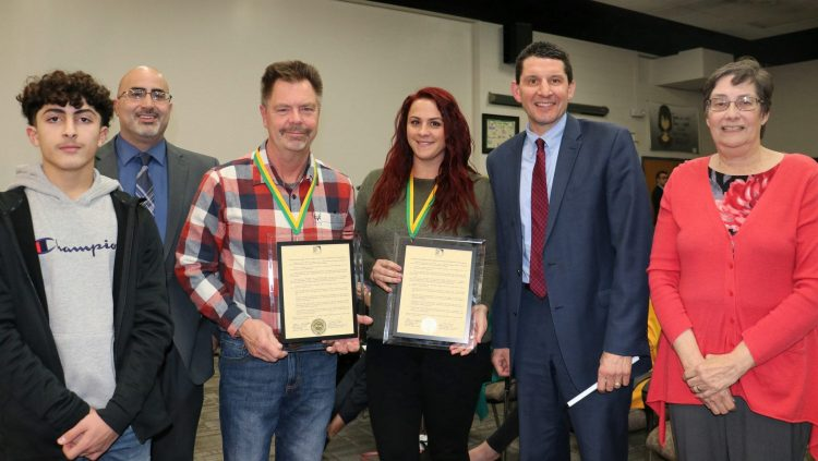 The Dearborn Public Schools Board of Education during their Monday, Dec. 9, 2019 meeting recognized two teachers for saving a student's life during a medical emergency on Oct. 2. In the photo from left are student Mohammad Hannawi, McCollough/Unis Principal Chadi Farhat, teacher Brian Courtright, teacher Emily Bartley, Dearborn Schools Superintendent Glenn Maleyko and School Board President Mary Petlichkoff.