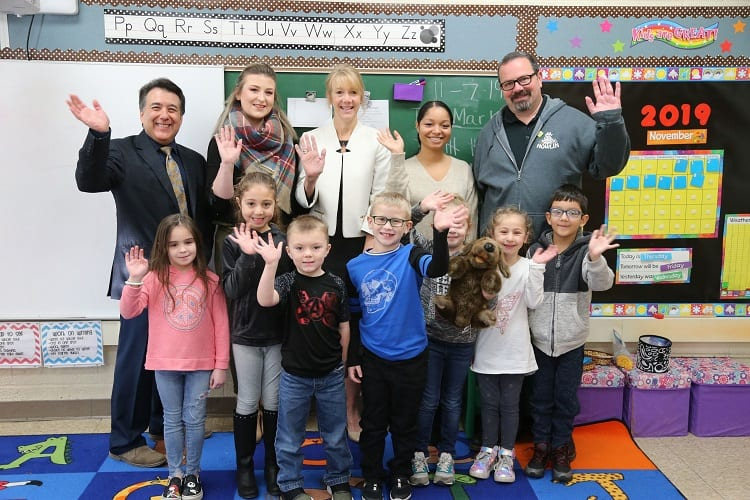 Adults and students pose in a Nowlin classroom after the Dearborn Education Foundation and DFCU Financial donated to the school.