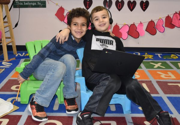 Two young students at Becker Elementary in Dearborn smile for the camera in February 2020.