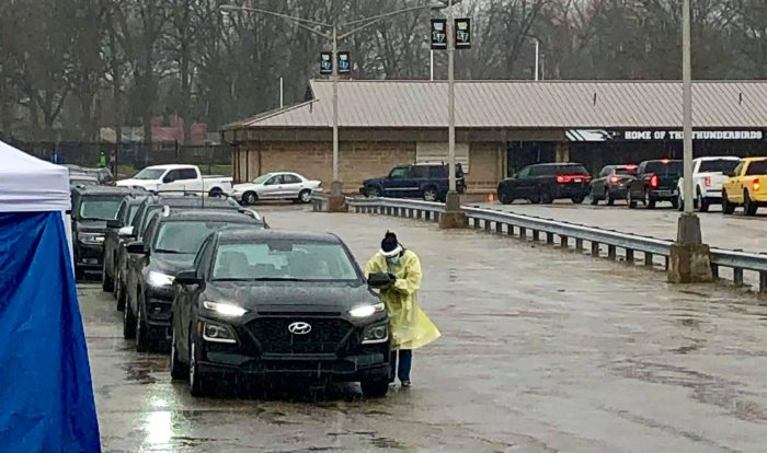 A line of cars waits in the rain for COVID testing at Edsel Ford High School on April 5, 2021.