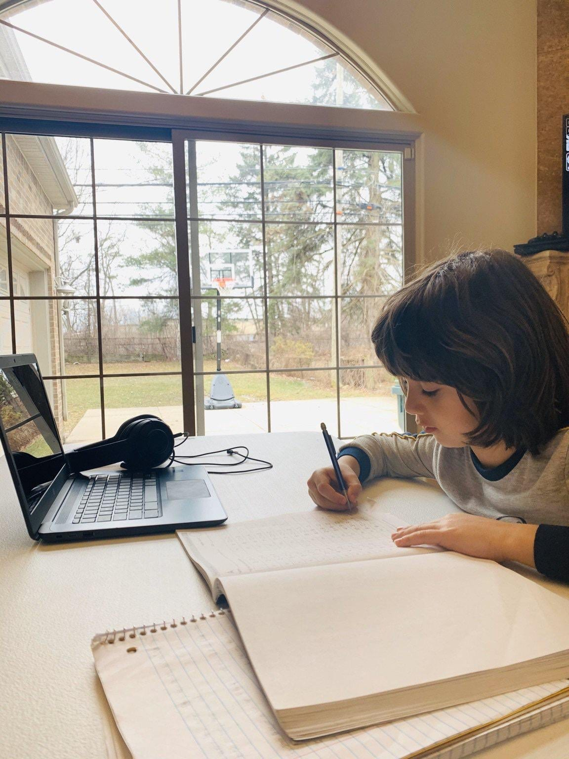 A Dearborn Public School student works from home in the spring of 2020.