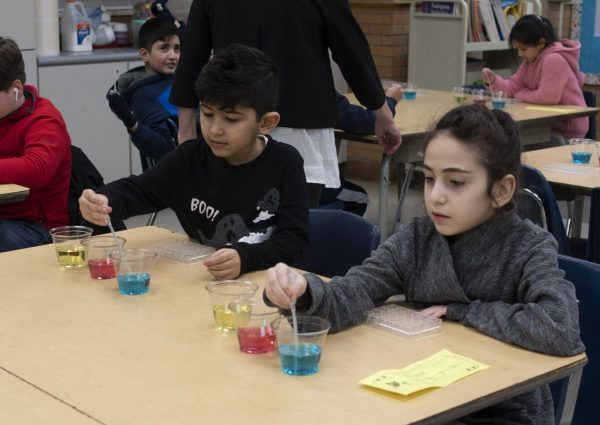 Two students work on a science experiment at Nowlin Elementary STEAM Night in February 2020.