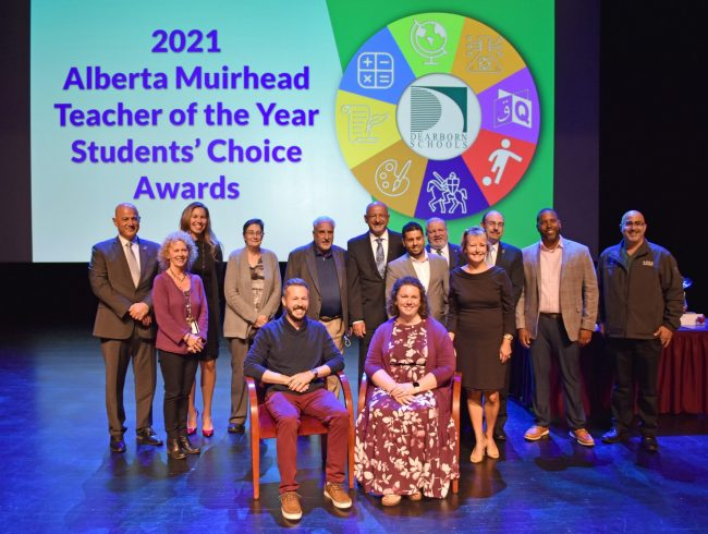 Group of people at the 2021 Alberta Muirhead Teacher of the Year Student Choice Awards. Congratulations to all the nominees for this year's Alberta Muirhead Student Choice Teacher of the Year Awards and especially to the four award recipients: P-2 Teacher of the Year Katie Borrello of William Ford Elementary, Grades 3-5 Teacher of the Year Ryan Dayne of Maples Elementary, Middle School Teacher of the Year Clinton Crace of Unis, and High School Teacher of the Year Fady Konstantinidis of Fordson. Pictured in the photo from the left are Dearborn Heights Mayor Bill Bazzi, Dearborn Public Schools Executive Director of Student Achievement Jill Chochol, Dearborn Schools Trustee Irene Watts, Trustee Mary Petlichkoff, Grade 3 - 5 Teacher of the Year recipient Ryan Dayne of Maples Elementary (sitting), Trustee Patrick D'Ambrosio, Trustee Hussein Berry, Grade P-2 Teacher of the Year recipient Katie Borrello of William Ford Elementary (sitting), Trustee Adel Mozip, Dearborn Area Chamber of Commerce Education Committee Chair Phillip Emma, Chamber President Jackie Lovejoy, School Board President Jim Thorpe, LaFontaine Automotive Group Director of Finance Imports David Lawrence, and McCollough/Unis Principal Chadi Farhat.